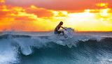 Surfer-wave-sunset-the-indian-ocean