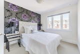 Silver and Purple Wallpaper in Bedroom