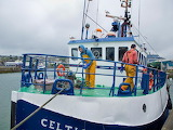 Howth harbor, fishermen tie up the boat after a night of fishing