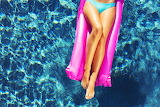 girl relaxing on a floating raft