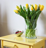 ^ Yellow tulips in vase