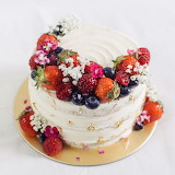 White cake with fruit on top