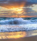 Waves coming ashore at sunset