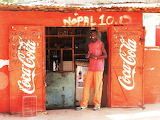 Young, man, smile, shop, orange, color, Gambia, Africa