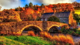 Stone Bridge and Country Home at Sunset