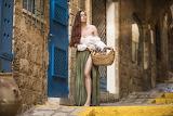 Girl, street, basket, building, skirt, door, blouse, cakes