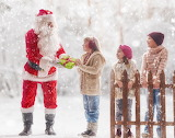 children receiving gift from Santa Claus