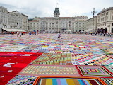 Trieste the square covered with crochet blankets