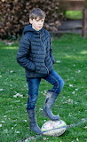 Boy in rubber boots