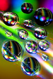 Rainbow color explosion in water drops