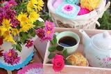 Bouquet of flowers, cup of tea, teapot, wool, crochet work