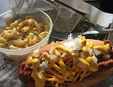^ Hot dog, chili, mustard, onions, mac ' cheese