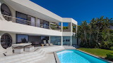 Luxury white modern villa, pool and garden