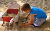 Boy playing sand 2