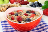 a-bowl-of-cereal-with-milk-fruit-and-fresh-berries