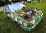 VW Polo transformed into a flower bed, by Frank Rumpenhorst