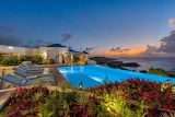 Luxury white ocean view villa at sunset, St. Martin, Caribbean