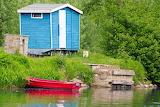 Boat-river-hut-trees-grass