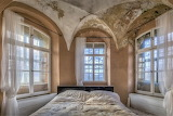 Vaulted ceiling bedroom with lots of windows