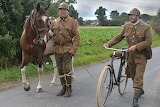 soldiers with horse and bike