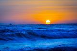 blue sunset /waves crashing at the beach