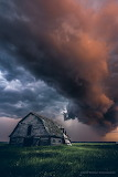 Storm clouds over old farm house hudson bay Canada