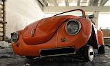 Red VW bug in garage