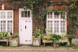 Door and windows on old brick house