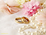 Wedding rings with flowers and pearls