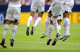 soccer players jumping