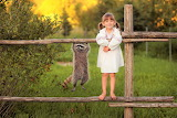 Young girl with raccoon pet