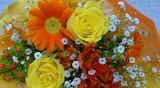 ^ Gerbera, roses, gypsophila, chrsanthemum bouquet