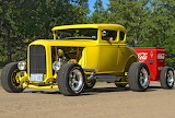 Ford hotrod with Coca Cola trailer.