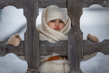 girl peeking through the fence