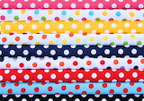 Colorful stacks of polka-dot fabric