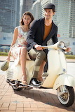 couple is traveling by scooter