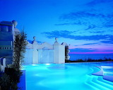 Luxury torquoise pool at night