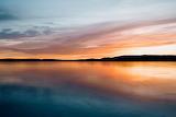Sunrise On Calm Waters