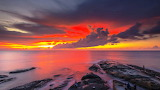 Red-sky-dark-clouds-reflection-Sunset-at-the-Coast-of-Borneo-Mal