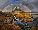 Iceland. Rainbow over the mountain Kirkjufell