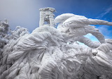 Ice Formations Atop a Windswept Mountain in Slovenia