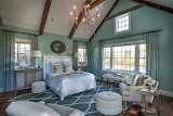 Mint bedroom with a-frame beamed ceiling