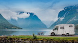 Camper-lake-mountains-clouds-landscape