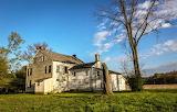 Abandoned rural house broken trees