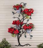 ^ Hanging Tree Trellis holding Christmas Poinsettias - © 2016 Pl