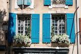Blue, windows, flowers, street lamp, house, facade, detail