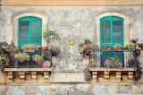 Balconies, flower pots, windows