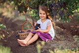 beautiful girl with basket of grapes