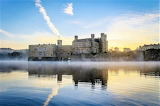 Morning mist at Leeds Castle in middle of a Lake England