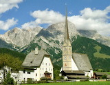 Maria Alm parish church with Steinernes Meer range, Austria
